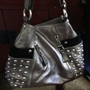 Silver leather bag with pockets with silver studs